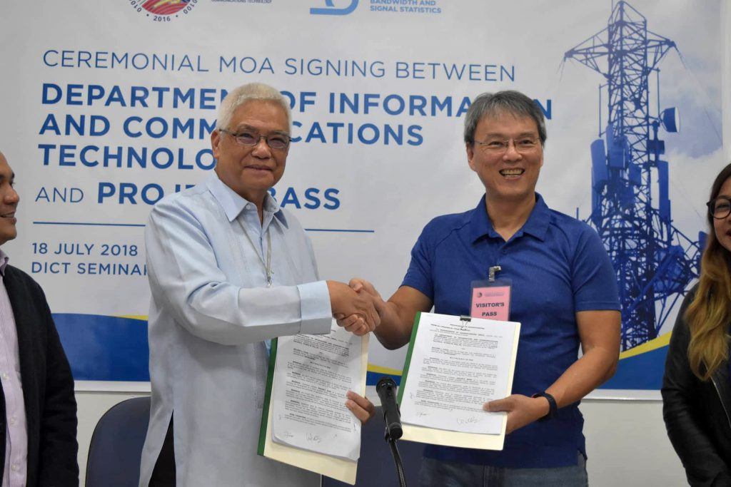 MOA Signing between DICT Acting Secretary Eliseo Rio, Jr. and Project Bass' developer Wilson Chua
